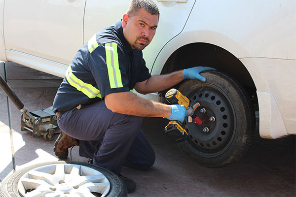roadside replacing flat tire